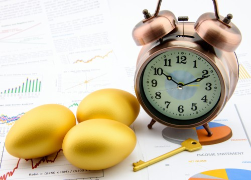 Three golden eggs and a golden key with a clock on business and financial reports : Key success in sustainable growth investment concept